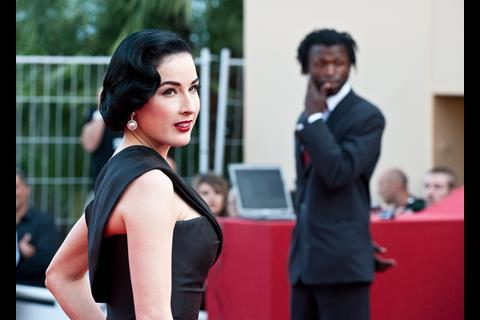 """Actress Dita von Teese arrives at the premiere of """"Inglorious Basterds"""" at the 62nd Cannes Film Festival in Cannes."""